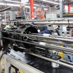 Manufacturing falls slightly on weak automobile output
