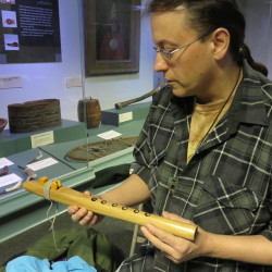Rolfe Richter, a Passamaquoddy flute player and flute maker from Perry, Maine, holds one of his handmade wooden flutes.