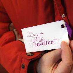 """Ribbons and cards bearing the message """"We all matter"""" were given to those attending the vigil for the homeless at the Hammond Street Congregational Church in Bangor on Sunday."""