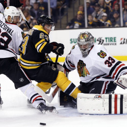 Bruins' Bergeron, Chicago's Toews could miss Game 6 Monday night