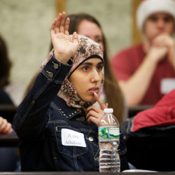 Casco Bay High School junior Judy Albdoor raises her hand with a question Monday at the University of Maine Law School in Portland during a workshop with the dean. The workshop was part of the Street Law program, designed to increase awareness of legal professions among high school students, specifically among minorities.