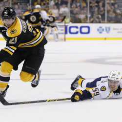 Bruins clinch top spot in Eastern Conference with 5-2 win