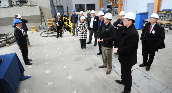 People tour the Advanced Structures and Composites Center during a press event at the University of Maine in Orono.