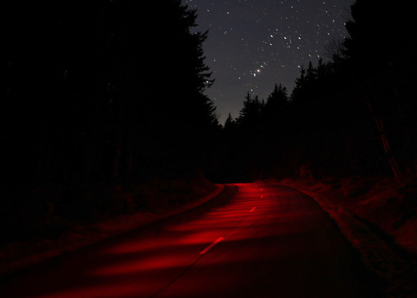 The constellation Orion sets in the western sky over the Park Loop Road in a 30-second exposure made on a moonless night in Acadia National Park.