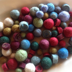Maine woman uses old buttons to craft fine jewelry