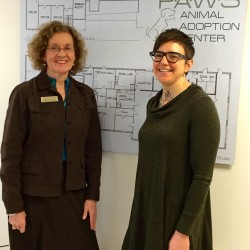 Camden National Vice-President Joanne Campbell (left) looks over the plans for the new P.A.W.S. facility with Executive Director Amie Hutchison.