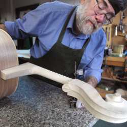Bangor-based violin maker Nathan Slobodkin works on fitting the neck of a cello at his shop.  This is one of the last major steps in making an instrument like this.  Slobodkin worked with extreme caution to make a perfect fit and also to ensure the neck will line up perfectly with the body of the instrument.