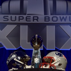 A general view of the Vince Lombardi Trophy and helmets for the Seattle Seahawks and New England Patriots during a press conference for Super Bowl XLIX at Phoenix Convention Center.