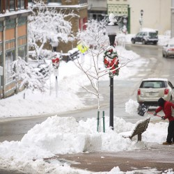 Heavy snow knocks out power to more than 100,000 in Maine