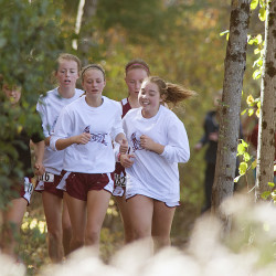 The Orono girls cross-country team takes a cool-down lap after competing in the Eastern Maine championship in Belfast in this October 2014 file photo.