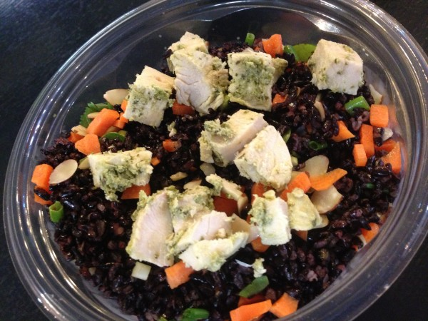 A salad made with warm black rice called the emperor is one of a half-dozen warm salads at Daily Greens in the Portland Public Market House. It's served with chicken, carrots, almonds, cilantro and scallions on mixed greens.