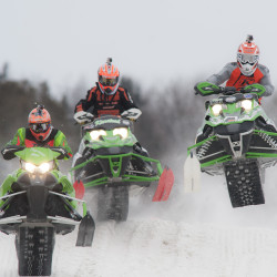 Competitors speed over a customized groomed oval track at Bass Park during the East Coast Snocross in Bangor Sunday.