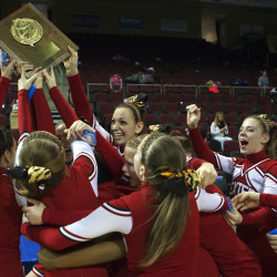 The Dexter High School team holds up the first place trophy after winning the Eastern Maine Class C Regional cheerleading competition Saturday at the Cross Insurance Center in Bangor.