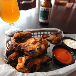 Grilled chicken wings pair well with Zephyr IPA, made by Rising Tide Brewing Co. in Portland. Both are served at the Nocturnem Draft Haus in Bangor.