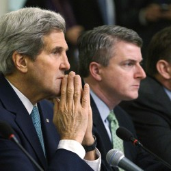 Secretary of State John Kerry and Special Representative for Afghanistan and Pakistan Dan Feldman listen during a meeting with Pakistani officials in Islamabad on Tuesday.
