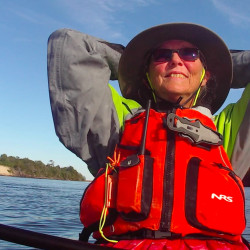 Deb Walters of Troy basks in the sun as she drifts along the coast of North Carolina on Dec. 20, day 80 of her solo kayaking journey from Maine to Guatemala to fundraise $150,000 to offer education to children and adults of Guatemala City garbage dump community.