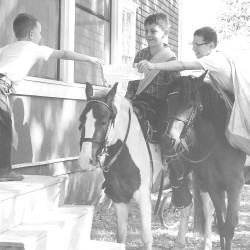 Bangor Daily News carriers deliver the newspaper by pony in this 1959 file photo.