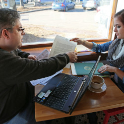 Jim Zaffiro, left, and his daughter Emily Zaffiro, 17, a student at Pius Catholic High School in Milwaukee, Wisconsin, work on filling out a FAFSA form, which determines how much and what types of financial aid students are eligible for when starting college.