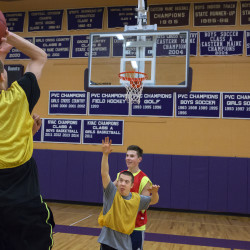 Dakota Clement (left), 16, shoots the ball in during unified basketball practice on Jan. 15 at Hampden Academy.