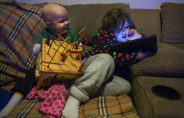 Tripp Murray, 3, plays with his sisters at their home in Bangor on Thursday. Tripp is currently in remission for brain cancer. Last year, he had a brain tumor removed and also underwent a bone marrow transplant.