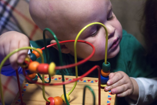 Tripp Murray, 3, looks to his sister while playing with a toy at their home in Bangor on Thursday. Tripp is currently in remission for brain cancer. Last year, he had a brain tumor removed and also underwent a bone marrow transplant.