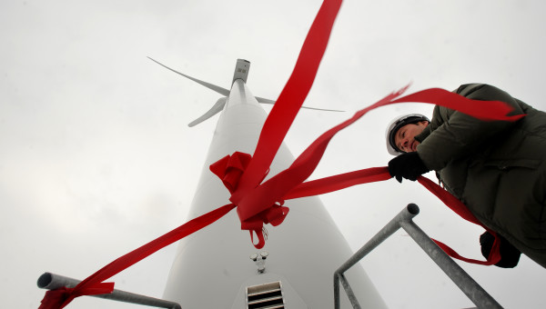 Bob Roy a wildlife biologist with Massacusets-based First Wind ties the ribbon to the guard rails of the wind turbine #1 at the Stetson Wind Project in T8-R3 in preparation for the ceremonial opening in this 2009 BDN file photo. The company started it's commercial operation of the 38 turbine 57 megawatt capacity project that started over two years ago. Maine Gov. John Baldacci and First Wind president and CEO Paul Gaynor spoke at the event.