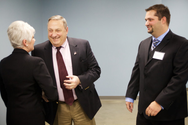 Gov. Paul LePage (center) shakes hand with South Portland Mayor Linda Cohen (left) after greeting Ken Cianchette of Jetport State Building LLC on Monday afternoon in South Portland.