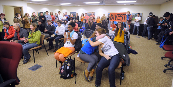 People react as the investment committee of the University of Maine board of trustees voted to divest from coal investments in the system's portfolio in this December 2014 file photo. The University of Maine System board of trustees voted unanimously Monday to partially divest itself from investments in the coal industry.