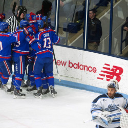 UMass Lowell celebrates after scoring on University of Maine's Matt Morris (right) during their hockey game Friday at Alfond Arena in Orono.