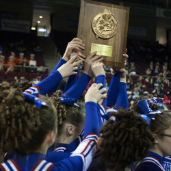 Central Aroostook Jr./Sr. High School cheerleaders hold up the championship trophy after winning the East/West Maine Class D regional cheerleading competition Saturday at the Cross Insurance Center in Bangor.
