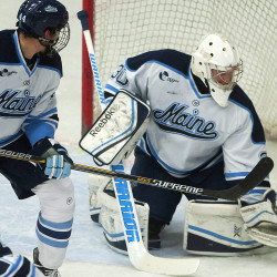University of Maine's Sean Romeo (right) makes a save from Canisius during their hockey game at Alfond Arena in Orono on Friday.