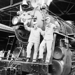 Gov. Burton M. Cross (left) and E. Spencer Miller, president of Maine Central Railroad, wave from the front of Steam locomotive 470 at Union Station in Bangor in this 1954 file photo.