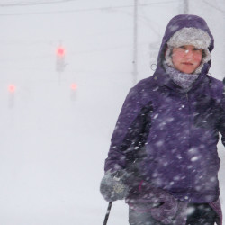 """Annetta Weatherhead of Portland skis up Congress Street on Tuesday. """"It's the best,"""" said Weatherhead of skiing in Portland during a snowstorm. """"We always come out whenever it snows."""""""