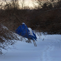 An alleged homeless person's camp is seen under the I-395 bridge Wednesday in Bangor.