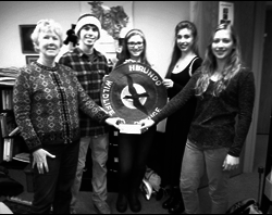 University of Maine Green Team members gathered to pass on the gift of $160. Pictured from left to right Gloria Vollmers, Treasurer, Hirundo Wildlife Trust, Jayson Peltier (Philanthropy Chair), Paige Theberge (member),  Gwen Walsh (Social Chair), and  handing over the check is Sabrina Vivian (President).