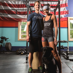 Owners of Stone Coast CrossFit, Nick Brown and Lily Hamill, and their dog Beacon.