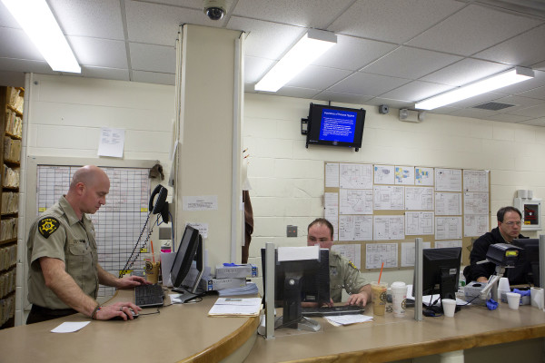 Officers work to book inmates at intake at the Penobscot County Jail in Bangor on Feb. 12.