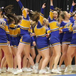 The Hermon High School cheerleading team gets pumped up before taking the floor in the State Class B Cheerleading Competition at the Augusta Civic Center on Saturday.  The Hawks cheerleaders won their fifth straight Class B state title.
