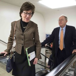 Senators Susan Collins (R-ME) and Lamar Alexander (RTN) make their way to the Senate chamber to vote on a series of amendments on the bill to authorize the Keystone XL pipeline on Capitol Hill in Washington January 21, 2015.