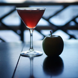 """Justin Douglass of the Inn By the Sea in Cape Elizabeth concocted a drink inspired by the Oscar-nominated movie """"Grand Budapest Hotel"""" and its key plot point, a painting called """"Boy With Apple."""" It calls for Jack Daniels, Absolute Orient Apple, pomegranate juice, a splash of champagne and an apple garnish"""