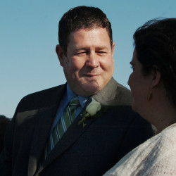 John Holyoke and his wife, Karen, exchange vows on the Bangor Waterfront.