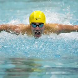 Ellsworth's Cooper Holmes competes in the 100 yard butterfly event during the Penobscot Valley Conference boys swimming and diving championship on Feb. 6 in Bangor. An impending snowstorm has caused many sports schedules to be changed for this weekend.