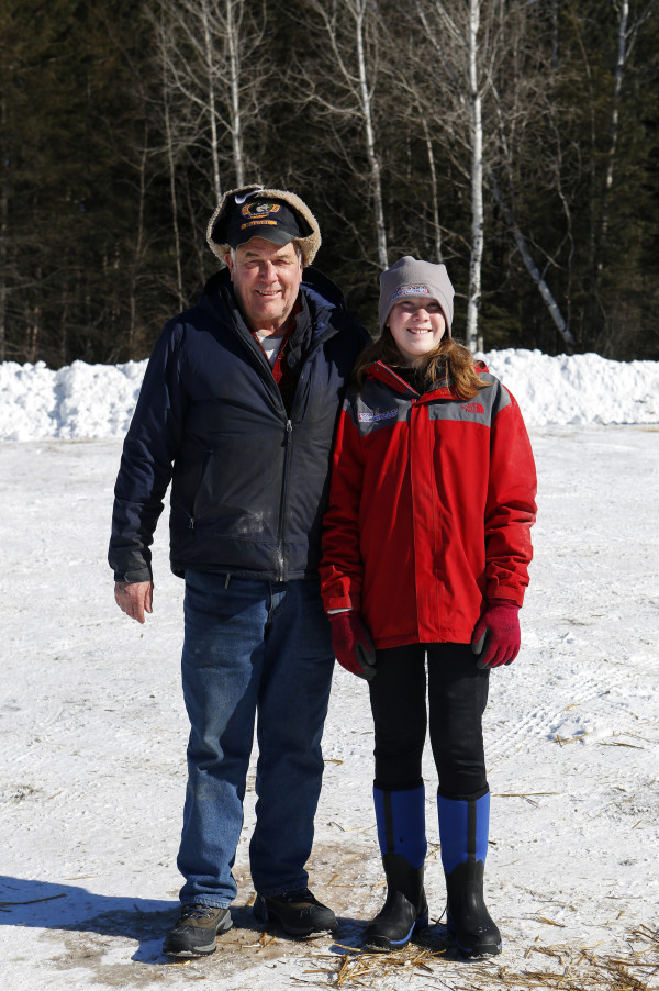 Spencer Thew (left), 73, from South Colton, New York, and Lara Renner, 12, from Alton, New Hampshire, pose for a portrait outside the Lonesome Pine Ski Lodge in Fort Kent Friday. Thew and Renner are the oldest and youngest mushers competing in the Can-Am races this weekend. Thew is competing in the 60-mile race and Renner is competing in the 30-mile race.