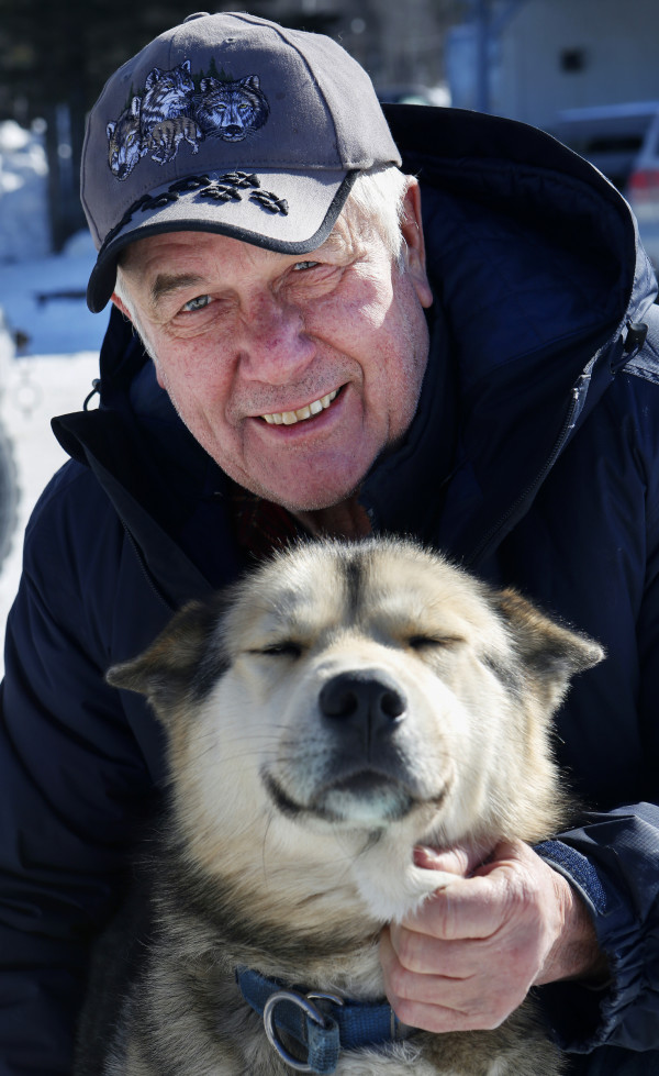 Spencer Thew, 73, from South Colton, New York, poses for a portrait with one of his sled dogs, McTavish, out of his truck outside the Lonesome Pine Ski Lodge in Fort Kent Friday. Thew is the oldest musher competing in the Can-Am races this weekend. He is competing in the 60-mile race.