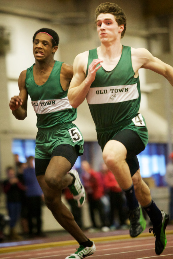 Old Town High School teammates Thomas Darby (left) and Nicolas Boutin run in the 55-meter dash at the Class B indoor track state meet in Lewiston on Monday. Boutin won the event in 6.73 seconds.