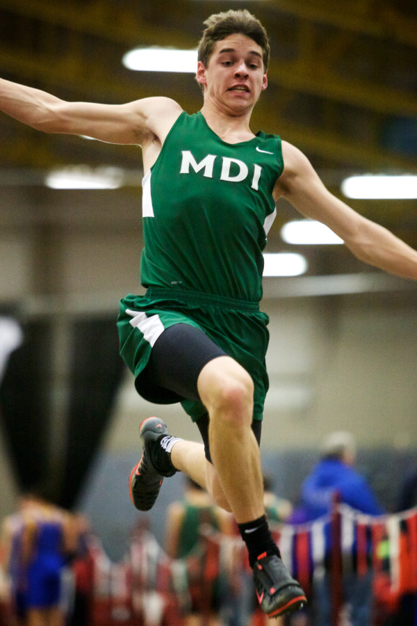Ryan Bender of Mount Desert Island High School leaps in the long jump at the Class B indoor track state meet in Lewiston on Monday.