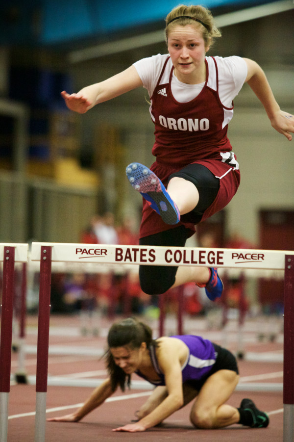 Lauren Stoops of Orono High School clears the last hurdle in the 55 meter finals at the Class B indoor track state meet in Lewiston on Monday. Stoops placed second.