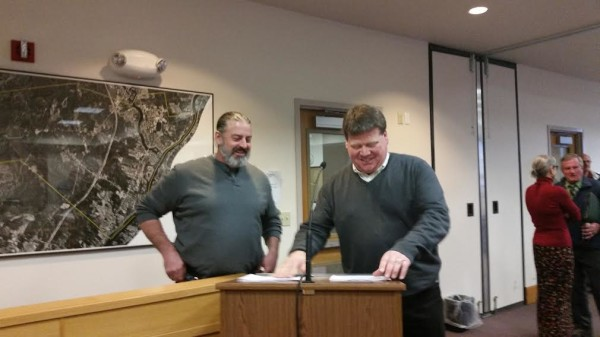 Maine Review Committee board Chairman Chip Reeves (left) and Craig Stuart-Paul, Fiberight's chief executive, sign a development agreement that aims to solve the solid waste disposal needs of the committee's 187 member municipalities on Wednesday in Orono.