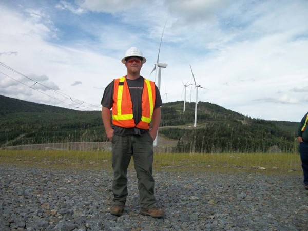 Jeff Cropley, a student in the wind power technology program at Northern Maine Community College, spent the summer as an intern for  independent power producer TransCanada. He is pictured here at the Kibby  Mountain wind farm project in western Maine. Cropley inspected the turbines and issued mechanical completion certificates.