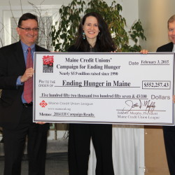 (L-R) Luke Labbe, Chair of the Maine Credit Union League's Social Responsibility Committee, which helps to coordinate the Maine Credit Unions' Campaign for Ending Hunger, Liz Murray, the subject of the Emmy-nominated movie, Homeless to Harvard: The Liz Murray Story, and author of the New York Times best-selling book, Breaking Night, about her childhood spent being hungry and homeless, and John Murphy, President of the Maine Credit Union League, hold a big check representing the record-setting total raised by the Maine Credit Unions' Campaign for Ending Hunger in 2014.  The results were announced on February 3, 2015, in Freeport.  Murray was the featured speaker.